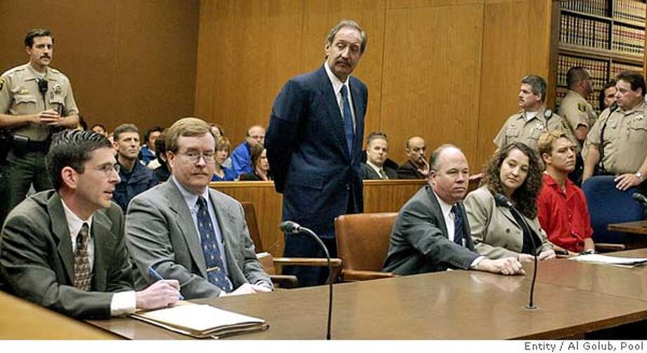 ** ADVANCE FOR USE MONDAY, MAY 31, 2004 - FILE ** Defense attorney Mark Geragos, standing center, listens as senior deputy district attorney Rick Distaso, left, speaks during a hearing for Scott Peterson, far right, in a Stanislaus County Superior courtroom May 2, 2003, in Modesto, Calif. Geragos, the mustachioed man in crisply pressed suits with a love for cigars and an easy swagger in his walk, is the man of the hour while Distaso is heading into the case of his career. Distaso is neatly groomed, nota hair out of place, a former Army attorney who attained the rank of captain. (AP Photo/Al Golub, Pool) Prosecutor Rick Distaso (left) and colleague David Harris (center) are pitted against defense attorney Mark Geragos (right). Prosecutor Rick Distaso (left) and colleague David Harris (center) are pitted against defense attorney Mark Geragos (right). Prosecutor Rick Distaso (left) and colleague David Harris (center) are pitted against defense attorney Mark Geragos (right). Prosecutor Rick Distaso (left) and colleague David Harris (center) are pitted against defense attorney Mark Geragos (right). Ran on: 06-13-2004  Mark Geragos (standing), defense attorney for Scott Peterson, listens as Deputy District Attorney Rick Distaso (left) speaks in a Stanislaus County courtroom. At center is Dave Harris, Distaso's colleague. ADVANCE FOR USE MONDAY, JUNE 1, 2004- FILE Metro#MainNews#Chronicle#11/13/2004#ALL#5star##0421788908 Photo: AL GOLUB