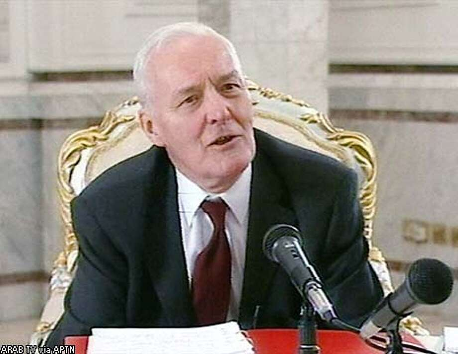 "Retired British lawmaker Tony Benn interviews Iraqi President Saddam Hussein in Baghdad Sunday, Feb. 2, 2003. Benn conducted the 40-minute interview Sunday in Baghdad for a new television network called ""Arab Television,"" a yet-to-be-launched Arab TV station with administrative offices in London.(AP Photo/ARAB TV via APTN) ** TV OUT **"