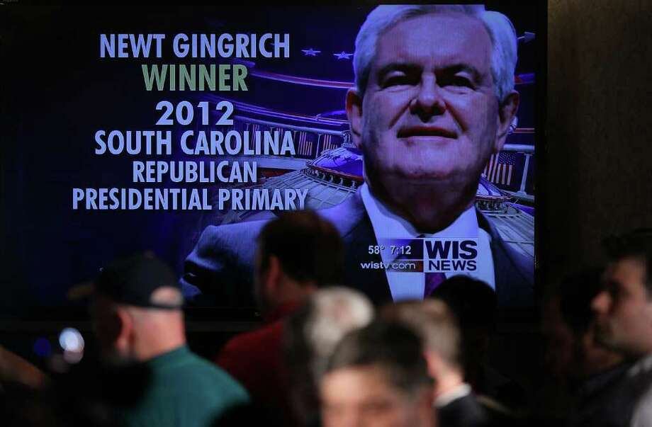 COLUMBIA, SC - JANUARY 21: The image of Republican presidential candidate, former Speaker of the House Newt Gingrich is projected on a screen at a primary night rally as he is announced as the winner of the South Carolina primary January 21, 2012 in Columbia, South Carolina.  After early returns several television networks have declared Gingrich the winner in South Carolina's primary, resulting in a different candidate emerging victorious in the first three contests for the Republican nomination. Photo: Mark Wilson, Getty Images / 2012 Getty Images