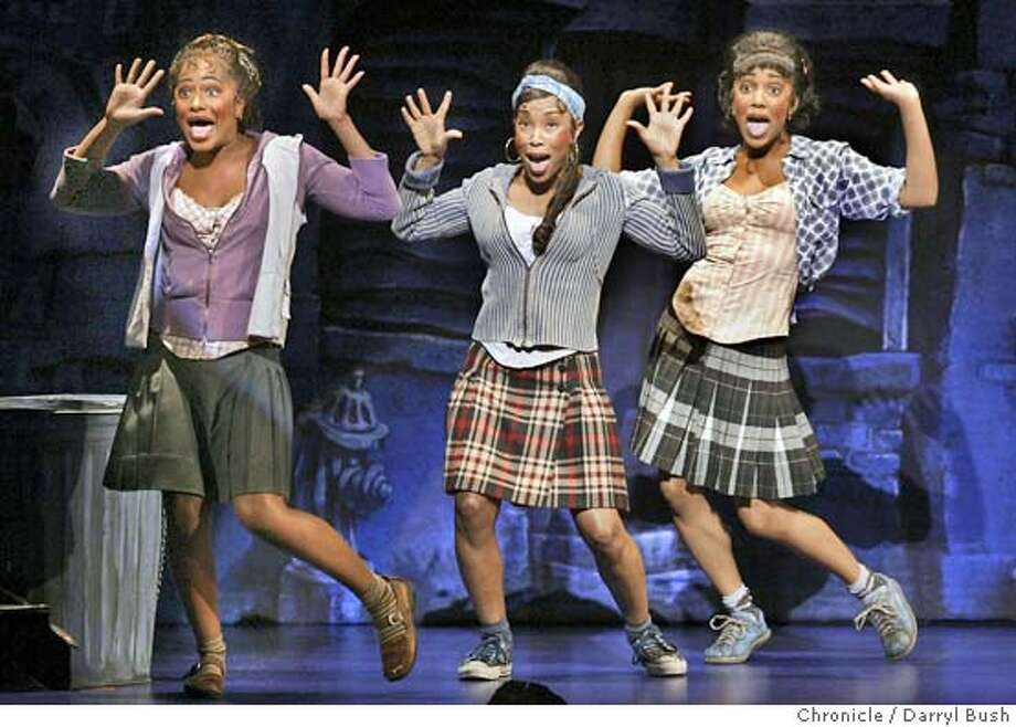 """From left: Amina S. Robinson as Crystal, LaTonya Holmes as Ronnette, and Yasmeen Sulieman as Chiffon sing and dance the opening song, """"Little Shop of Horrors,"""" in the first act of """"Little Shop of Horrors,"""" at the Golden Gate Theatre. 11/10/04 in San Francisco  Darryl Bush / The Chronicle Photo: Darryl Bush"""