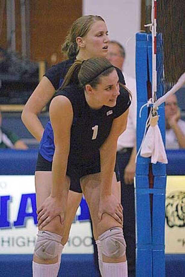 Sarah Illingworth, Analy's middle blocker and one of three senior starters, takes a break between points during a game in September.
