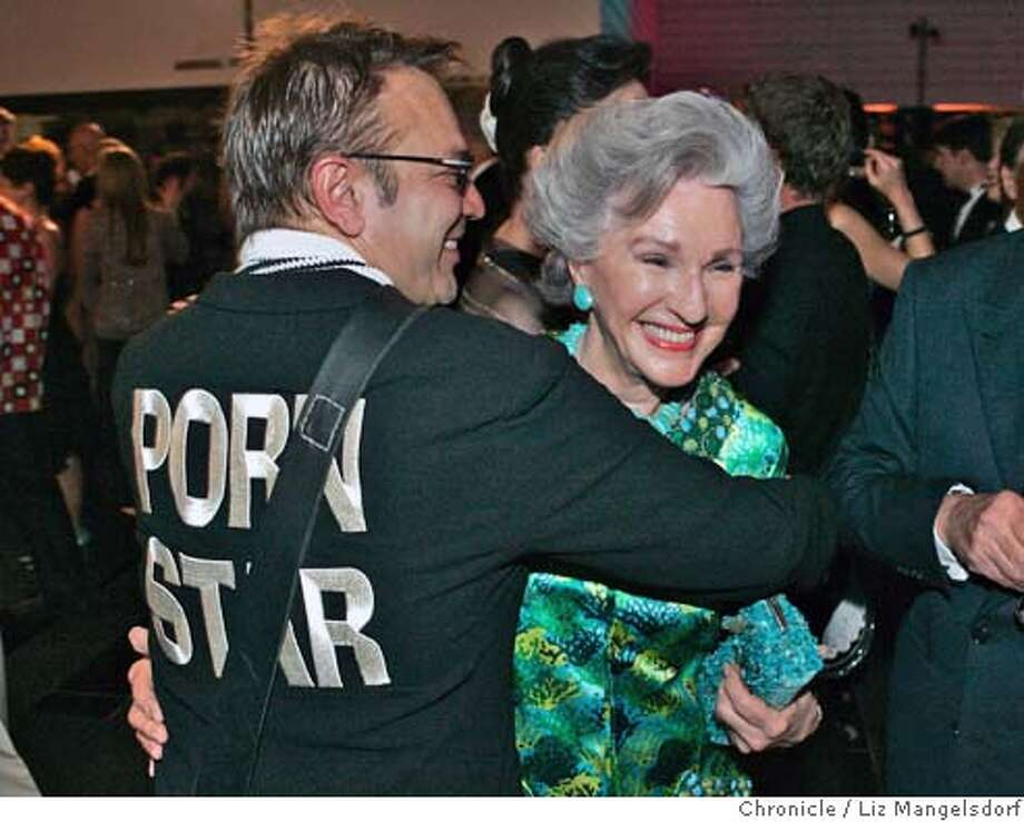 "modern07_076_lm.JPG Event on 5/4/05 in San Francisco.  SFMOMA's new gala: The Modern Ball, at the SFMOMA. Stanlee Gatti, left, wearing his ""Porn Star"" jacket hugs Elaine McKeon.  Liz Mangelsdorf / The Chronicle MANDATORY CREDIT FOR PHOTOG AND SF CHRONICLE/ -MAGS OUT Photo: Liz Mangelsdorf"