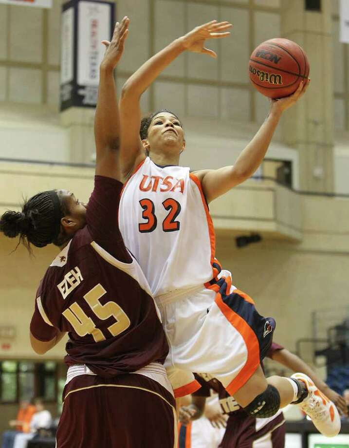 UTSA's Whitney Wright (32) goes up for a shot against Texas State's Ashley Ezeh (45) in women's basketball at UTSA on Saturday, Jan. 21, 2012. Kin Man Hui/San Antonio Express-News. Photo: ~