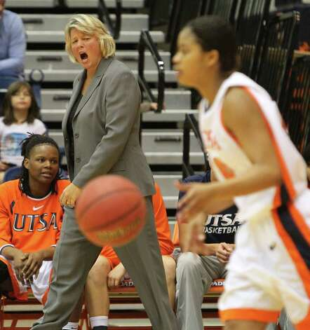 UTSA women's basketball coach Rae Rippetoe-Blair (left) urges her team on against Texas State at UTSA on Saturday, Jan. 21, 2012. Kin Man Hui/San Antonio Express-News. Photo: ~
