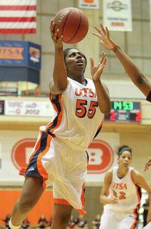 UTSA's Cori Cooper (55) drives to the basket for a shot against Texas State in women's basketball at UTSA on Saturday, Jan. 21, 2012. Kin Man Hui/San Antonio Express-News. Photo: ~