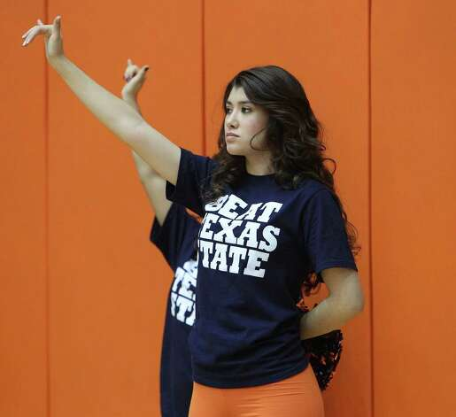 A member of the UTSA dance team shows the roadrunner sign during the women's basketball game against Texas State at UTSA on Saturday, Jan. 21, 2012. Kin Man Hui/San Antonio Express-News. Photo: ~