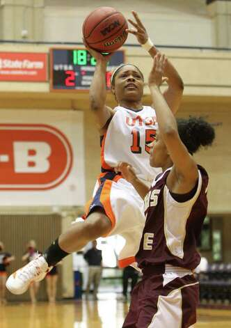 UTSA's Simone Young (15) takes a shot against Texas State's India Johnson (04) in women's basketball at UTSA on Saturday, Jan. 21, 2012. Kin Man Hui/San Antonio Express-News. Photo: ~