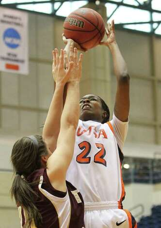 UTSA's Ashley Gardner (22) shoots over Texas State's Kelsey Krupa (30) in women's basketball at UTSA on Saturday, Jan. 21, 2012. Kin Man Hui/San Antonio Express-News. Photo: ~