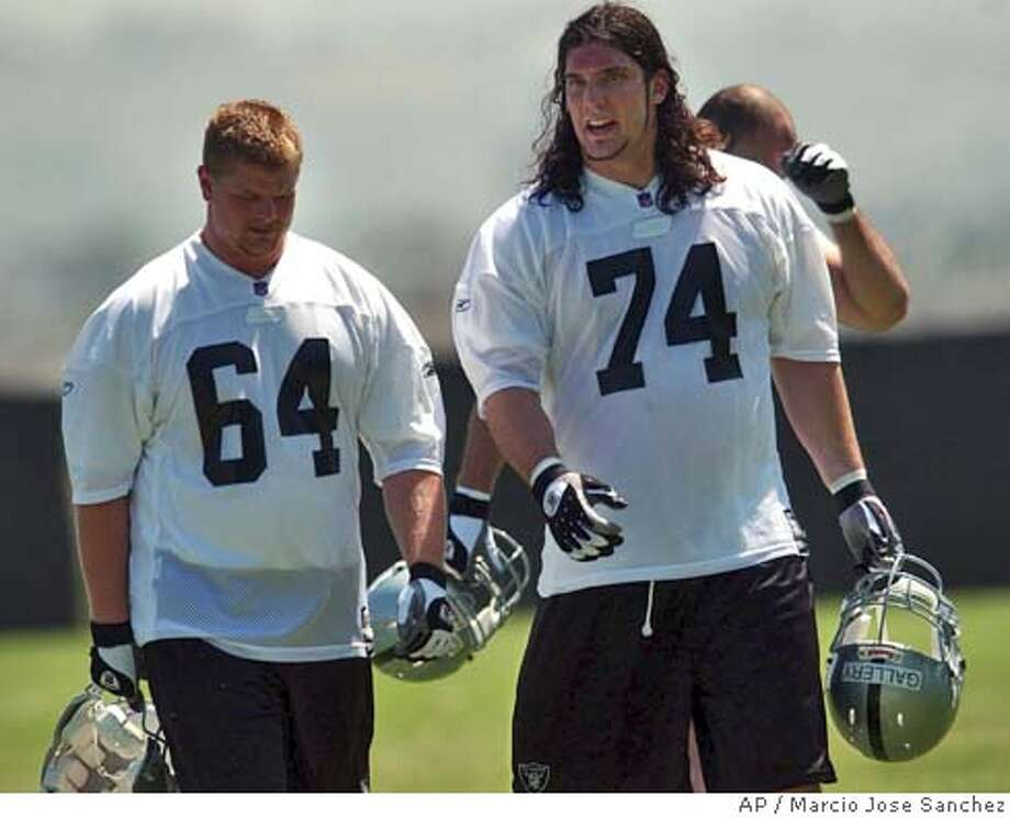 Offensive tackle Robert Gallery (74) and center/guard Jake Grove (64), the Oakland Raiders' first two picks in the draft, walk together during mini-camp in Oakland, Calif. on Friday, April 30, 2004. (AP Photo/Marcio Jose Sanchez)  ALSO RAN: 09/07/2004  Ran on: 07-25-2004  ProductName	Chronicle Ran on: 07-25-2004  ProductName	Chronicle Ran on: 07-25-2004  ProductName	Chronicle Ran on: 08-07-2004  Rookie Jake Grove has been working with the first unit with Adam Treu out with a shoulder injury. Ran on: 08-07-2004  Rookie Jake Grove has been working with the first unit with Adam Treu out with a shoulder injury. Ran on: 08-07-2004  Rookie Jake Grove has been working with the first unit with Adam Treu out with a shoulder injury. Ran on: 09-07-2004  Whether Robert Gallery, the Raiders' first-round draft choice, will start in the season opener against Pittsburgh is still undetermined. Ran on: 09-07-2004  Whether Jake Grove, the Raiders' second-round draft choice, will start in the season opener against Pittsburgh is still undetermined. Ran on: 09-07-2004  Whether Jake Grove, the Raiders' second-round draft choice, will start in the season opener against Pittsburgh is still undetermined. Ran on: 11-04-2004 Ran on: 11-04-2004 Ran on: 11-04-2004 Ran on: 11-04-2004 Sports#Sports#Chronicle#11/14/2004#ALL#2star##0421742554 Photo: MARCIO JOSE SANCHEZ