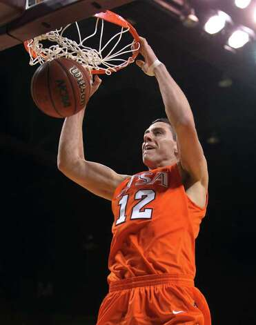 UTSA's Jeromie Hill (12) dunks against Texas State in men's basketball in San Marcos on Saturday, Jan. 21, 2012. UTSA defeated Texas State, 80-75. Kin Man Hui/San Antonio Express-News Photo: Kin Man Hui, ~ / San Antonio Express-News