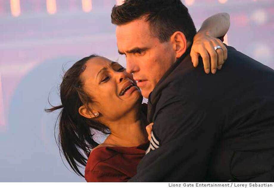 CRASH06 Christine Thayer (Thandie Newton) and Officer Ryan (Matt Dillon) in Crash. Lorey Sebastian/Lions Gate Entertainment