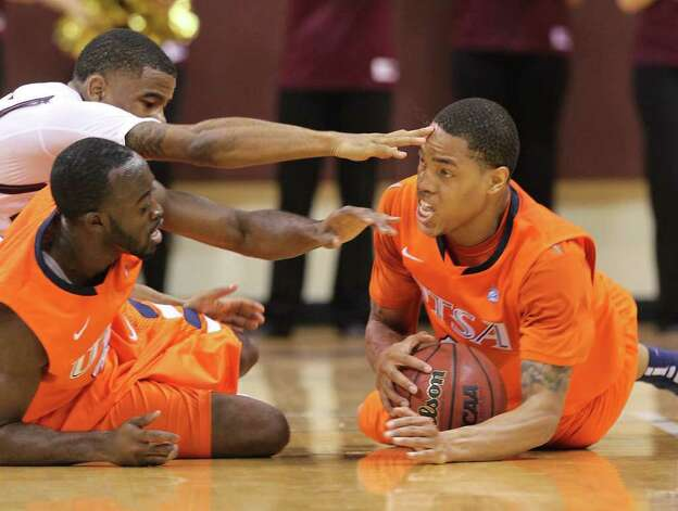 UTSA's Stephen Franklin (right) gets control of a loose ball as Texas State's Vonn Jones (top left) nearly jabs Franklin in the eye while he, Franklin and Sei Paye (04) tangle for the ball in men's basketball in San Marcos on Saturday, Jan. 21, 2012. UTSA defeated Texas State, 80-75. Kin Man Hui/San Antonio Express-News Photo: Kin Man Hui, ~ / San Antonio Express-News