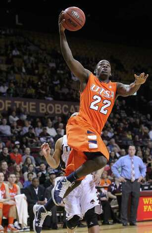 UTSA's Kannon Burrage (22) goes high to the hoop against Texas State in men's basketball in San Marcos on Saturday, Jan. 21, 2012. UTSA defeated Texas State, 80-75. Kin Man Hui/San Antonio Express-News Photo: Kin Man Hui, ~ / San Antonio Express-News
