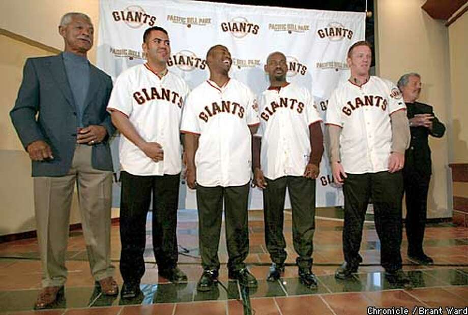 The Giants introduced some of their new players Monday including their manager Felipe Alou, left, Edgardo Alfonzo, Ray Durham, Marquis Grissom, (MISSING NAME. Moss?) and Brian Sabean in background. By Brant Ward/Chronicle Photo: BRANT WARD