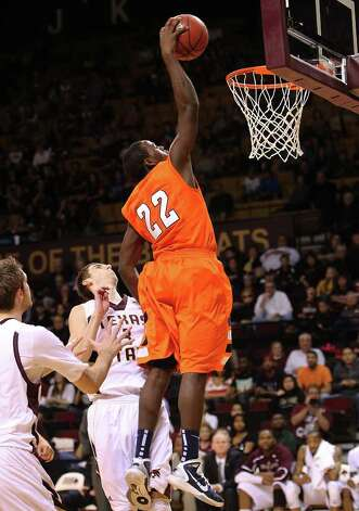 UTSA's Kannon Burrage (22) dunks over Texas State in men's basketball in San Marcos on Saturday, Jan. 21, 2012. UTSA defeated Texas State, 80-75. Kin Man Hui/San Antonio Express-News Photo: Kin Man Hui, ~ / San Antonio Express-News