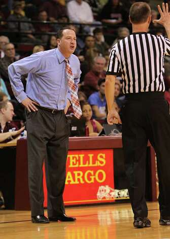 UTSA basketball coach Brooks Thompson (left) debates a call with an official during their game against Texas State in men's basketball in San Marcos on Saturday, Jan. 21, 2012. UTSA defeated Texas State, 80-75. Kin Man Hui/San Antonio Express-News Photo: Kin Man Hui, ~ / San Antonio Express-News