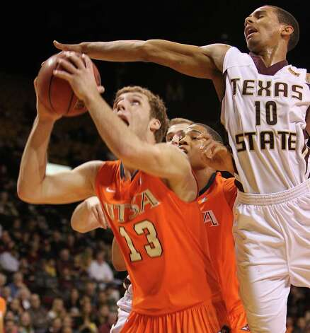 UTSA's Igor Nujic (13) attempts to go back up for a shot as Texas State's Wesley Davis (10) tries to swat the ball away in men's basketball in San Marcos on Saturday, Jan. 21, 2012. UTSA defeated Texas State, 80-75. Kin Man Hui/San Antonio Express-News Photo: Kin Man Hui, ~ / San Antonio Express-News
