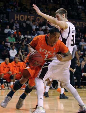 UTSA's Stephen Franklin (01) attempts to drive the baseline around Texas State's Reid Koenen (03) in men's basketball in San Marcos on Saturday, Jan. 21, 2012. UTSA defeated Texas State, 80-75. Kin Man Hui/San Antonio Express-News Photo: Kin Man Hui, ~ / San Antonio Express-News