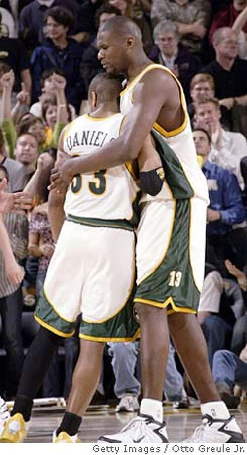SEATTLE - APRIL 23: Jerome James #13 of the Seattle SuperSonics gets a hug from Antonio Daniels #33 after scoring a basket late in the fourth quarter against the Sacramento Kings in Game one of the Western Conference Quarterfinals during the 2005 NBA Playoffs on April 23 at Key Arena in Seattle, Washington. NOTE TO USER: User expressly acknowledges and agrees that, by downloading and/or using this photograph, User is consenting to the terms and conditions of the Getty Images License Agreement. (Photo by Otto Greule/Getty Images) *** Local Caption *** Jerome James;Antonio Daniels Photo: Otto Greule Jr