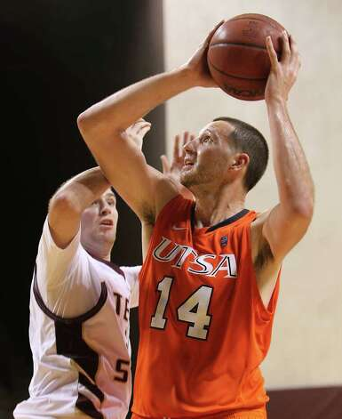 UTSA's Alex Vouyoukas (14) goes for a shot against Texas State's Matt Staff (21) in men's basketball in San Marcos on Saturday, Jan. 21, 2012. UTSA defeated Texas State, 80-75. Kin Man Hui/San Antonio Express-News Photo: Kin Man Hui, ~ / San Antonio Express-News