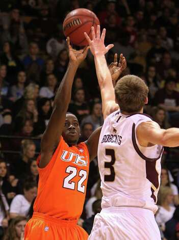 UTSA's Kannon Burrage (22) shoots for three against  Texas State's Reid Koenen (03) in men's basketball in San Marcos on Saturday, Jan. 21, 2012. UTSA defeated Texas State, 80-75. Kin Man Hui/San Antonio Express-News Photo: Kin Man Hui, ~ / San Antonio Express-News