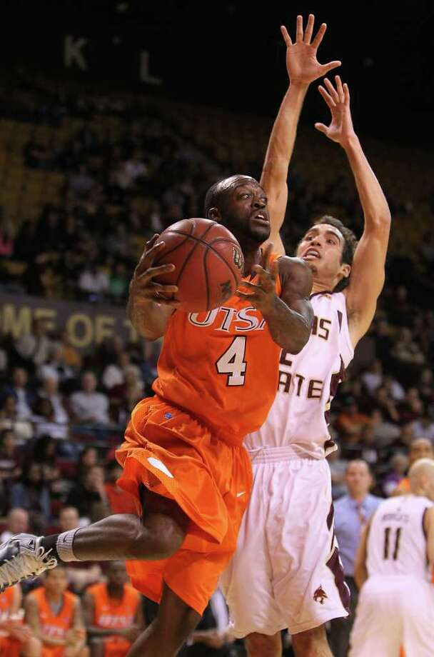UTSA's Sei Paye (04) looks to pass the ball against Texas State's Brooks Ybarra in men's basketball in San Marcos on Saturday, Jan. 21, 2012. UTSA defeated Texas State, 80-75. Kin Man Hui/San Antonio Express-News Photo: Kin Man Hui, ~ / San Antonio Express-News