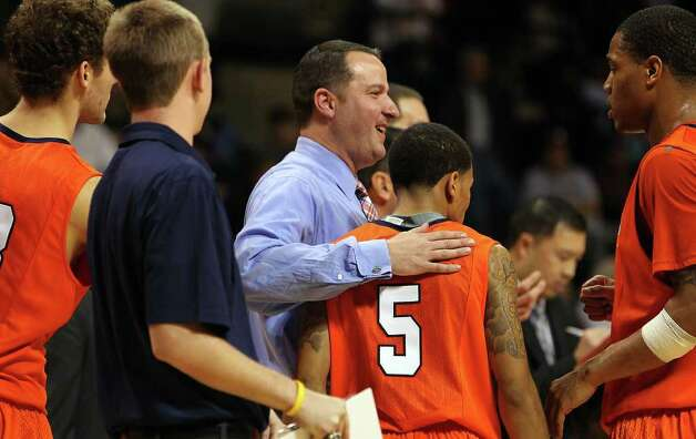 UTSA coach Brooks Thompson (center) pats point guard Michael Hale, III (05) on the back as the Roadrunners fought off Texas State and grabbed a victory in men's basketball in San Marcos on Saturday, Jan. 21, 2012. UTSA defeated Texas State, 80-75. Kin Man Hui/San Antonio Express-News Photo: Kin Man Hui, ~ / San Antonio Express-News