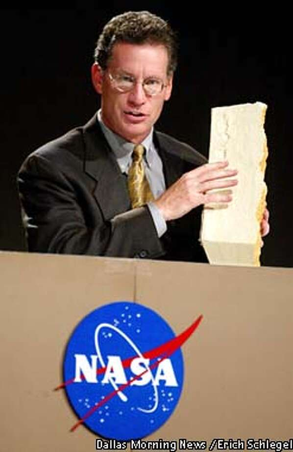 Shuttle program manager Ron Dittemore holds some of the foam insulation which is used on the space shuttle fuel tanks as he discusses the properties of the material during a news conference, Wednesday, Feb. 5, 2003, at Johnson Space Center in Houston. Following days of analysis, NASA backed away Wednesday from the theory that a piece of foam that struck Columbia during liftoff was the root cause of the space shuttle's disintegration over Texas. (AP Photo/Dallas Morning News / Erich Schlegel) Photo: ERICH SCHLEGEL
