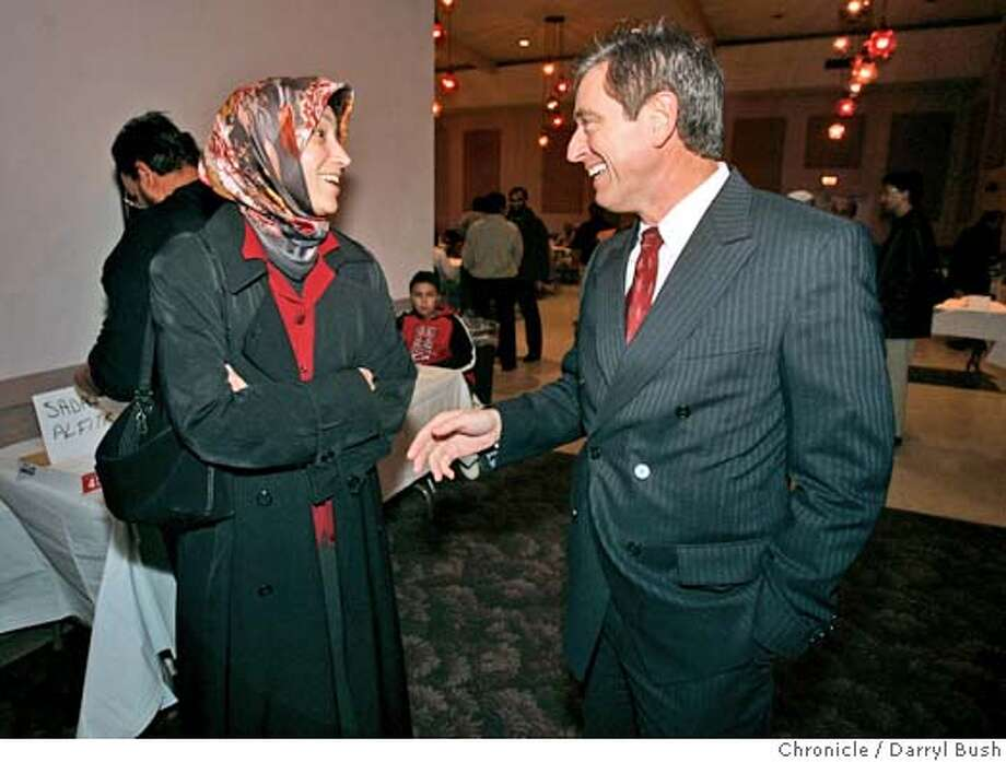 davis_002_db.jpg  San Jose Police Chief Robert Davis talks to Executive Director of Islamic Networks Group in San Jose, Maha ElGenaidi of Santa Clara, at a meeting of local Muslims at Napredak Hall. Davis has been fasting during sunup hours of Ramadan and meeting with families and groups of the Muslim community. 11/9/04 in San Jose  Darryl Bush / The Chronicle MANDATORY CREDIT FOR PHOTOG AND SF CHRONICLE/ -MAGS OUT Metro#Metro#Chronicle#11/13/2004#ALL#5star##0422460718 Photo: Darryl Bush