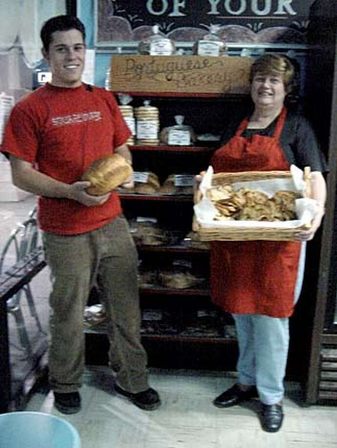 Mary Couto and her son, Gilbert, show off breads from the Portuguese Bakery in Santa Clara.