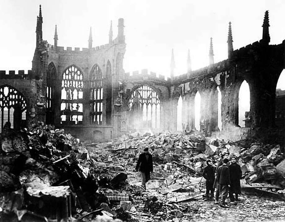 Coventry Cathedral, one of the finest examples of 14th Century Ecclesiastic architecture, lays in ruins after a German air raid on Nov. 14 during World War II in 1940. (AP Photo)