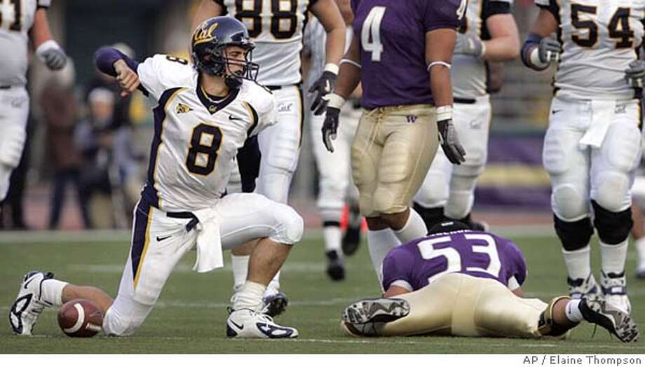 California quarterback Aaron Rodgers (8) reacts after rushing for 26 yards on a quarterback keeper in the third quarter, as Washington's Joe Lobednahn, who brought Rodgers down, is sprawled on the ground nearby Saturday, Nov. 13, 2004, in Seattle. California won 42-12. (AP Photo/Elaine Thompson) Photo: ELAINE THOMPSON