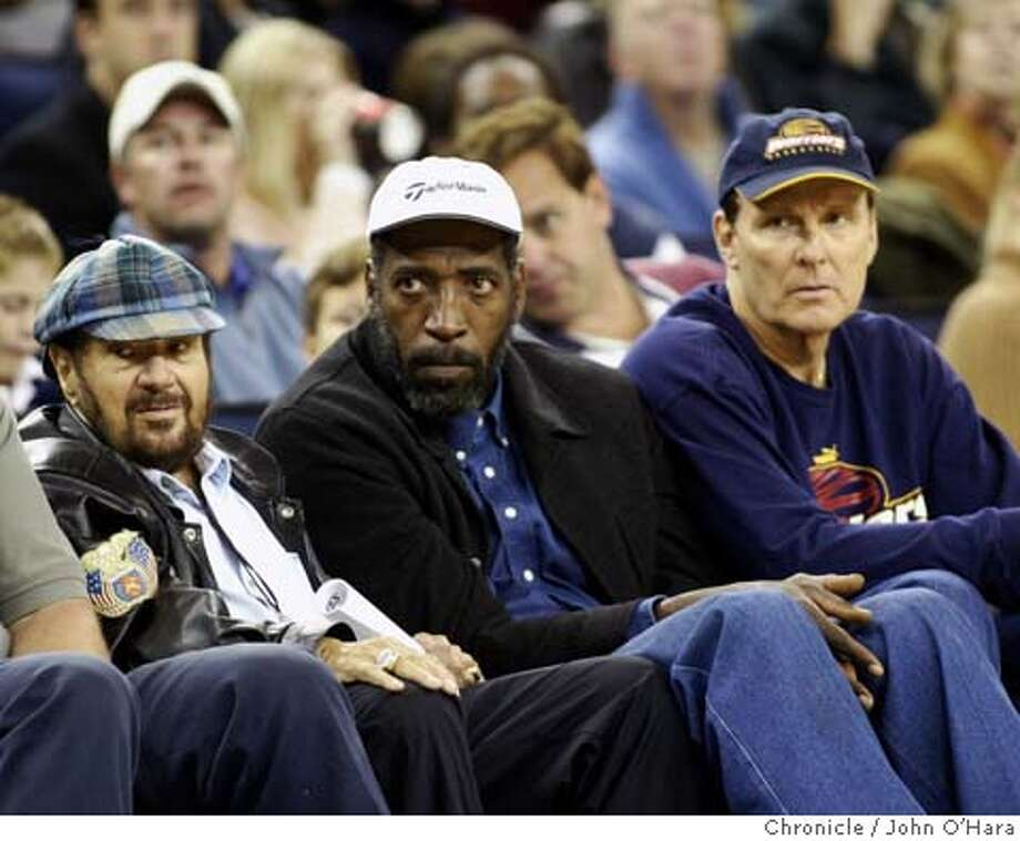 Warriors V/S Spurs  Opening night. An unusual occurance o the sidelines.  (left to right)  FRANKLIN Mieuli, Nate Thurman, and RIck Barry.  A not often seen trio  Photo/John O'Hara