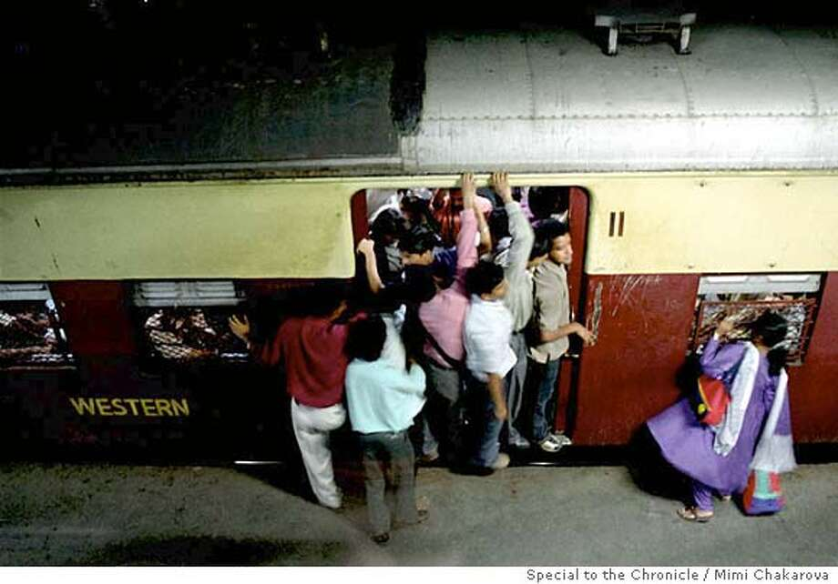 Rush-hour trains in Bombay are so crowded the doors are often left open to accommodate more riders. Photo by Mimi Chakarova, special to the Chronicle