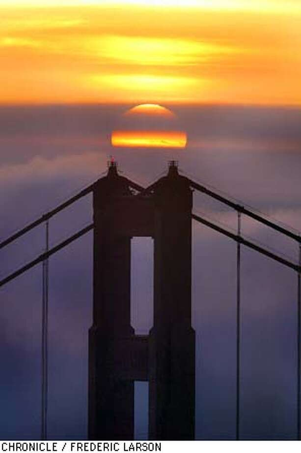 FOGSUN-C-29JAN03-MT-FRL: The city was socked in during the early morning hours (Wednesday) as the sunrise looking from the Marin Headlands finally busted through the fog that warmed up the Bay Area to spring like tempertures. Chronicle photo by Frederic Larson