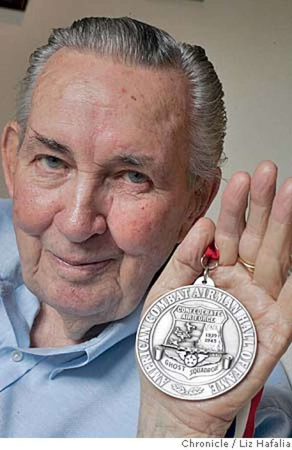 RYAN_083_LH.JPG This is a medal he received from President Bush. WWII vet Hap Halloran, shot down over Tokyo in 1945 went back recently to purge his nightmares from that day and meet the fighter pilot who shot him down.  � Shot on 11/9/04 in San Francisco. LIZ HAFALIA/The Chronicle MANDATORY CREDIT FOR PHOTOG AND SF CHRONICLE/ -MAGS OUT Nation#MainNews#Chronicle#11/11/2004#ALL#5star##0422460348 Photo: Liz Hafalia