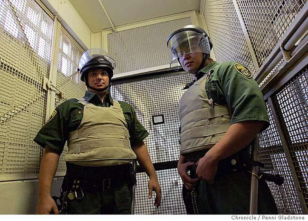 SANQUENTIN_357_pg.jpg two officers in this death row building and the protective outfits they wear. NO idents A tour of San Quentin prison's death row, to show how bad of shape it is in and drum up support for a new death row there. There is, of course, plenty of opposition to keeping death row on such a prime piece of real estate. . San Quentin on 10/26/04 by Penni Gladstone San Francisco Chronicle