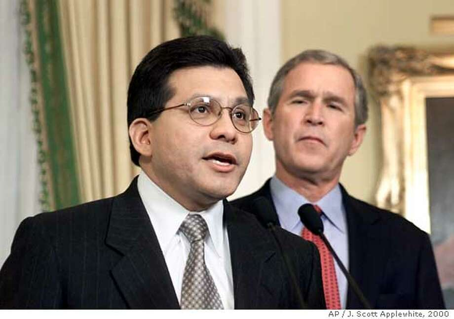 President-elect Bush listens to Alberto R. Gonzales, his choice as White House general counsel, during a ceremony at the Governor's Mansion in Austin, Texas, Sunday, Dec. 17, 2000. Gonzales, 45, is a justice on the Supreme Court of Texas. (AP Photo/J. Scott Applewhite) ALSO RAN 1/1/03 Photo: J. SCOTT APPLEWHITE