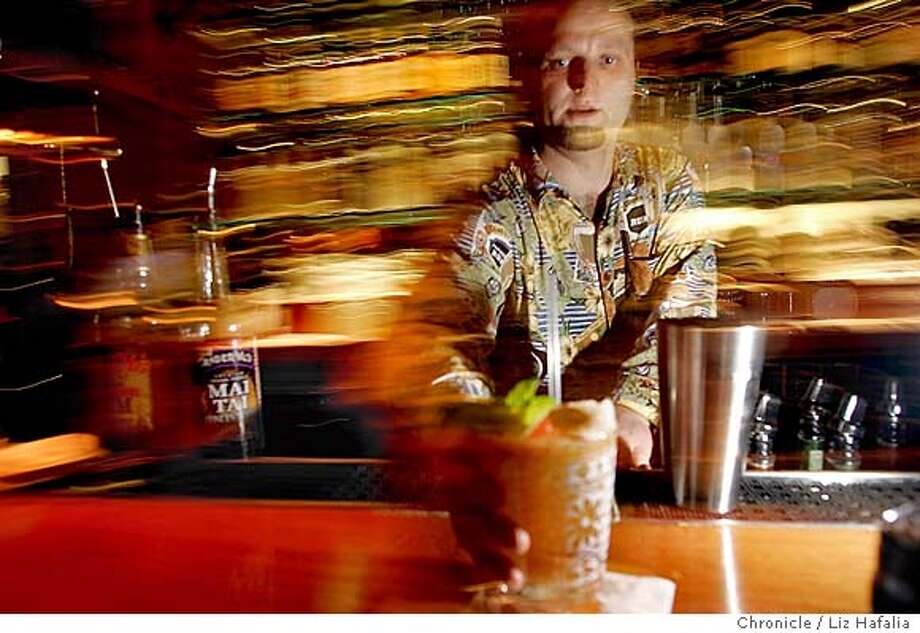 Illustrating a story on the history of the mai tai cocktail, assitant bar manager of Trader Vic's restaurant, Jim Shoemake, makes a mai tai.  Photo taken in San Francisco on 11/4/04, CA. by LIZ HAFALIA / San Francisco Chronicle Photo: LIZ HAFALIA