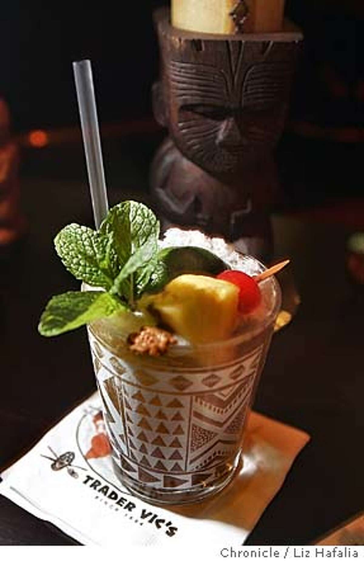 Illustrating a story on the history of the mai tai cocktail, assistant bar manager of Trader Vic's restaurant, Jim Shoemake, makes a mai tai. � Shot on 11/4/04 in San Francisco. LIZ HAFALIA/The Chronicle