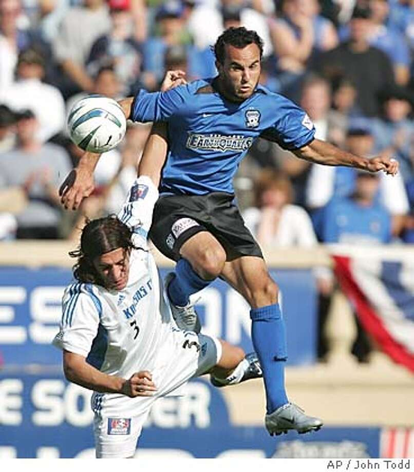 San Jose Earthquakes' Landon Donovan, right, jumps for a head ball above Kansas City Wizards' Nick Garcia, left, during the second half of the first game of the Western Conference playoffs in San Jose, Calif., Sunday, Oct. 24, 2004. The Earthquakes won, 2-0. (AP Photo/John Todd) Photo: John Todd