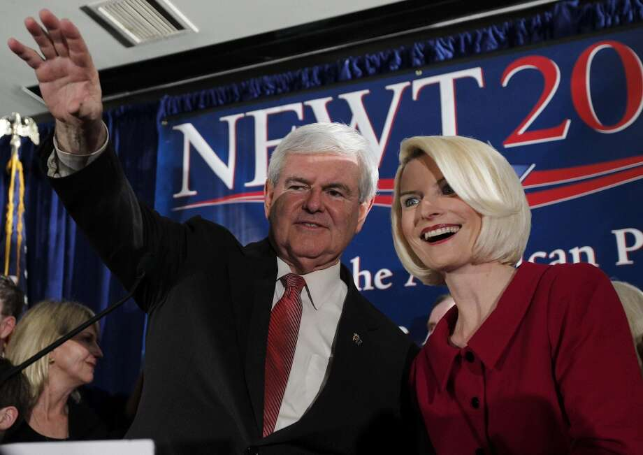 Republican presidential candidate and former House Speaker Newt Gingrich waves to the crowd with his wife Callista during a South Carolina Republican presidential primary night rally, Saturday, Jan. 21, 2012, in Columbia, S.C. Newt Gingrich won the South Carolina primary. (AP Photo/Matt Rourke)