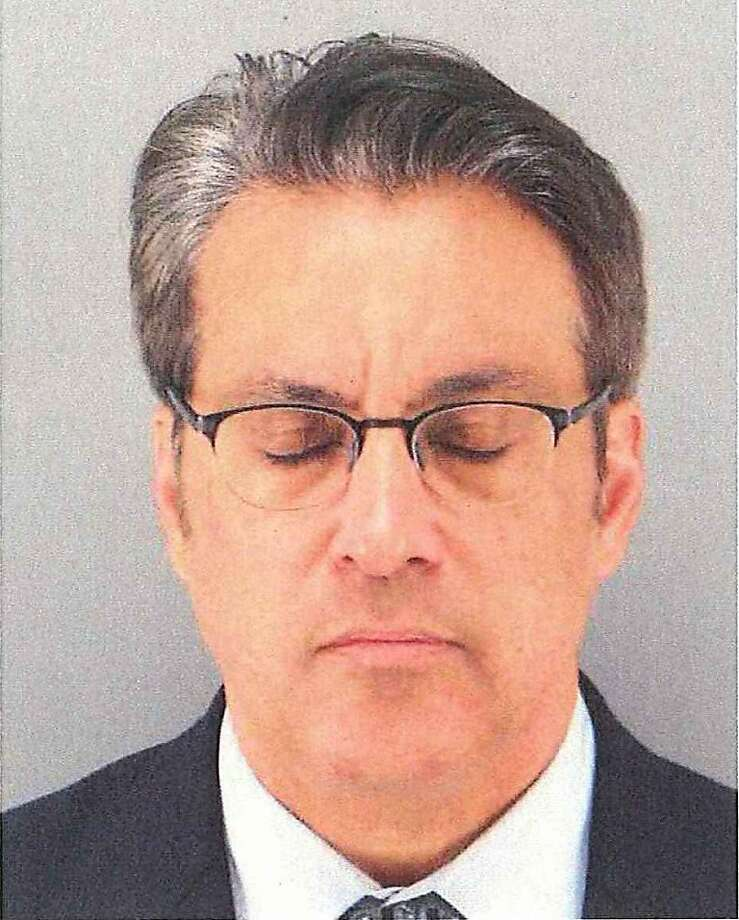San Francisco Sheriff Ross Mirkarimi's eyes-closed mug shot raises more questions. Photo: Associated Press