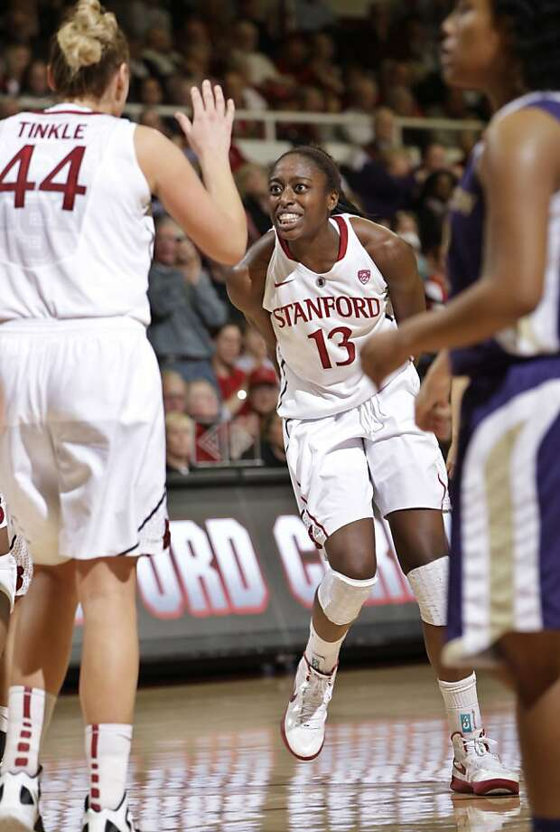 Stanford forward Chiney Ogwumike (13) celebrates in front of Stanford forward Joslyn Tinkle (44) after scoring against Washington in the second half of an NCAA college basketball game in Stanford, Calif., Saturday, Jan. 21, 2012. Stanford defeated Washington 65-47.  (AP Photo/Paul Sakuma) Photo: Paul Sakuma, Associated Press
