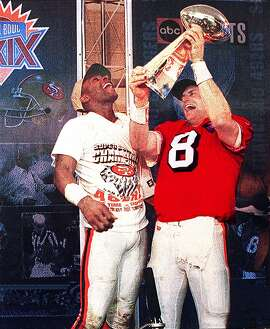 SUPER BOWL XXIX/c/31JAN95/SP/FREE; AC -----  49ers WR Jerry Rice (L), and QB Steve Young, celebrate with the Pete Rozelle trophy after their win over the San Diego Chargers in Super Bowl XXIX.   Photo for the San Francisco Chronicle by Alex Clausen ALSO RAN 01/19/03