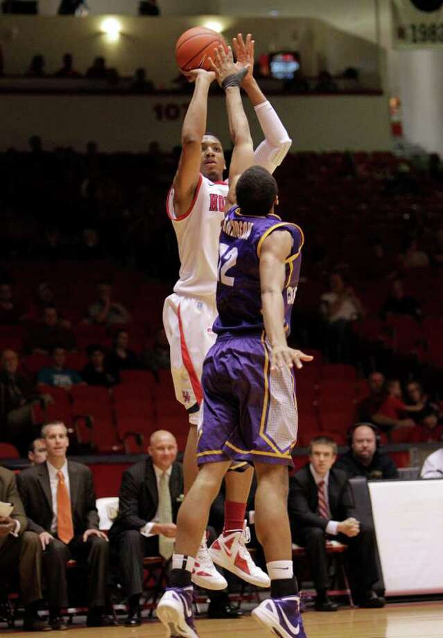Houston's TaShawn Thomas (35) shoots from the baseline corner over East Carolina's Robert Sampson (12) during the first half of a NCAA basketball game between the Houston Cougars and the East Carolina Pirates Saturday, January 21, 2012. Photo: Bob Levey, Houston Chronicle / ©2012 Bob Levey