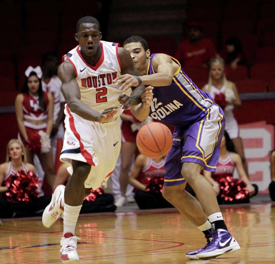 Houston's Alandise Harris (2) steps in front of East Carolina's Robert Sampson (12) to steal the ball during the second half of a NCAA basketball game between the Houston Cougars and the East Carolina Pirates Saturday, January 21, 2012. Houston won 82-76. Photo: Bob Levey, Houston Chronicle / ©2012 Bob Levey