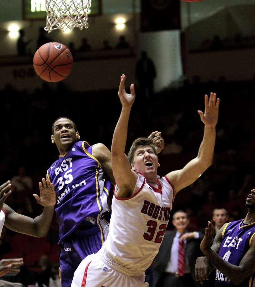 Houston's Kirk Van Slyke (32) looses the ball as he goes  to the basket during the second half of a NCAA basketball game between the Houston Cougars and the East Carolina Pirates Saturday, January 21, 2012. Houston won 82-76. Photo: Bob Levey, Houston Chronicle / ©2012 Bob Levey