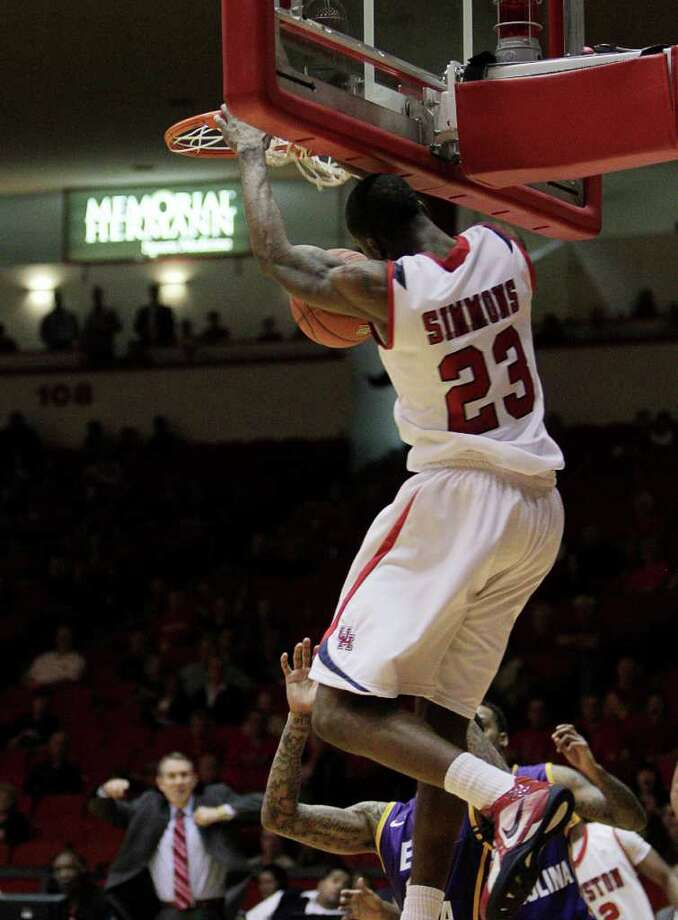 Houston's Jonathan Simmons (23) slams one home during the second half of a NCAA basketball game between the Houston Cougars and the East Carolina Pirates Saturday, January 21, 2012. Houston won 82-76. Photo: Bob Levey, Houston Chronicle / ©2012 Bob Levey