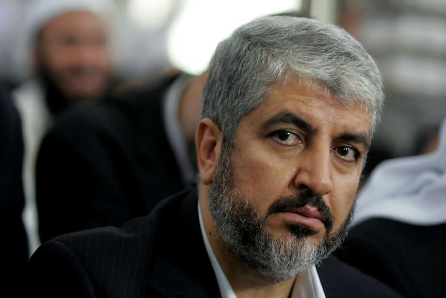 FILE - Khaled Mashaal, Hamas leader, center, attends his father's funeral at a Mosque in Amman, Jordan, in this Aug. 29, 2009 file photo. The Islamic militant group Hamas said in a statement e-mailed Saturday Jan. 21, 2012 that their chief, Khaled Mashaal, won't seek re-election.  (AP Photo/Nader Daoud, File) Photo: Nader Daoud, Associated Press